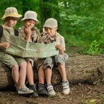 overnight summer camps,scout children camping and read map in forest